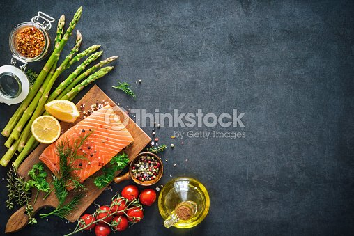 Fresh salmon fillet with aromatic herbs, spices and vegetables : Stock Photo