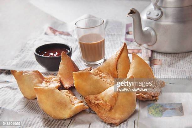 Fresh samosas with ketchup and hot chai ready for breakfast
