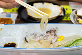 Fresh sashimi squid in restaurant at Hakodate Morning Market ( Nijo Market ), Hokkaido, Japan