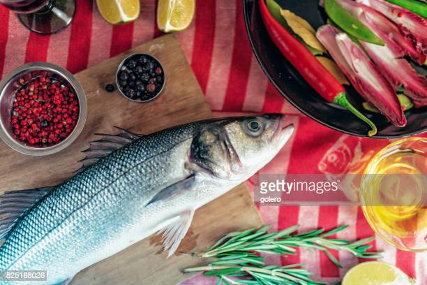 fresh sea bass on kitchentable