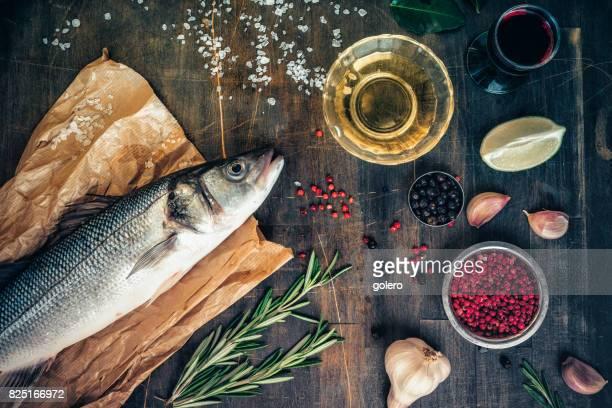 fresh sea bass on rustic kitchentable