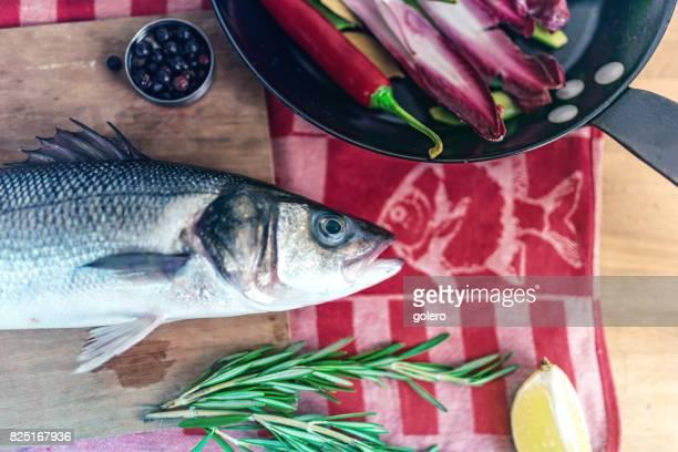 fresh sea fish on kitchentable