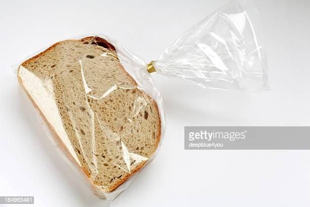 fresh sliced bread in transparent plastic folie  on white