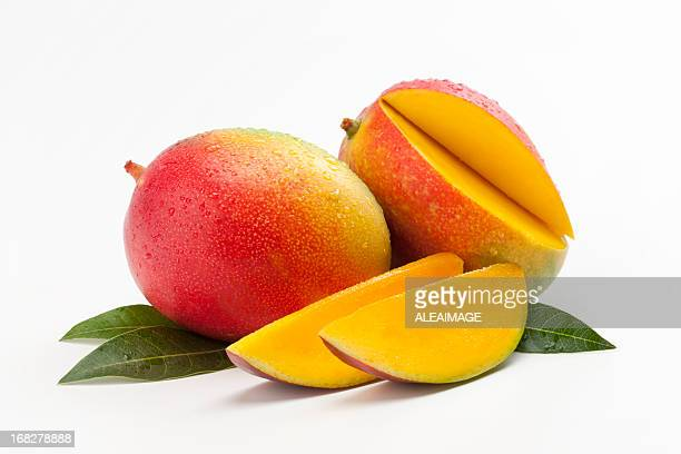 Fresh Slices of Mango on a Bed of Leaves