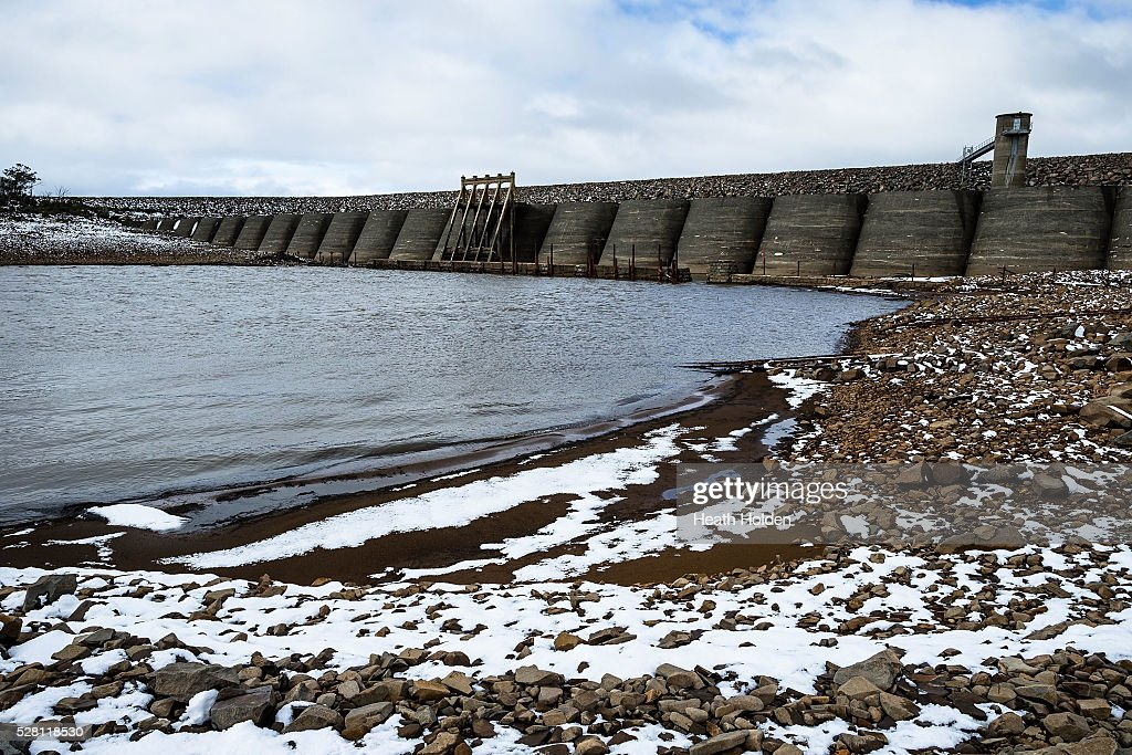Fresh snow and water lay around the dry dam wall area after several days of rain and snow on on May 4, 2016 in Great Lake, Australia. Heavy snow and rain fall in the area has seen much needed water flow into the lake. Tasmania's dams are at record lows due to lower than average rainfall with storage levels of dams used to generate hydro power below 15 per cent for the first time.