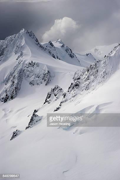 Fresh snow on steep mountain side