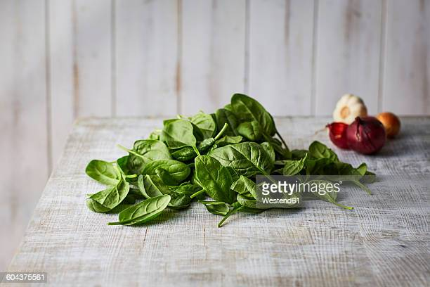Fresh spinach leaves on wood
