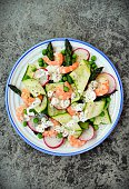 Fresh spring salad with vegetables and prawns