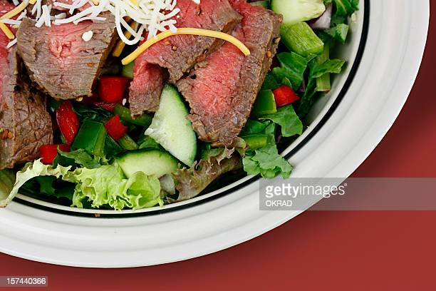Fresh steak salad from above with clipping path red