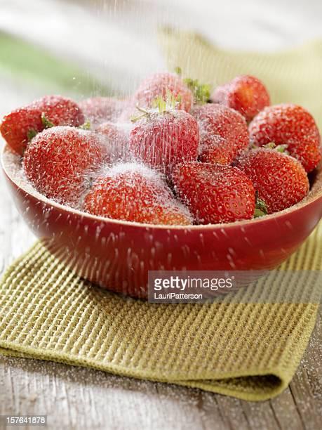 Fresh Strawberries being Sprinkled with Sugar
