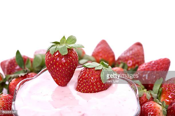 Fresh strawberries in flavored yogurt.