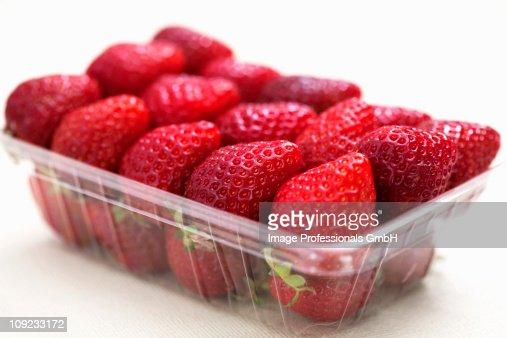 Fresh strawberries in plastic punnet