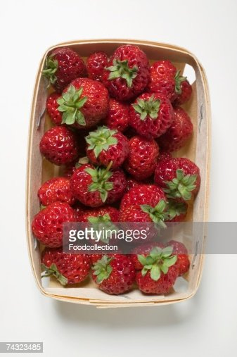 Fresh strawberries in woodchip basket