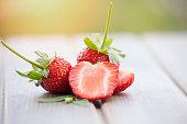 Fresh strawberries on wood background.