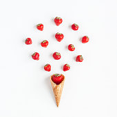 Fresh strawberry in waffle cone. Creative food concept. Flat lay, top view