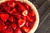 Fresh Strawberry Pie on a Distressed Wooden Table