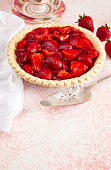 Fresh Strawberry Pie on a Pink Table