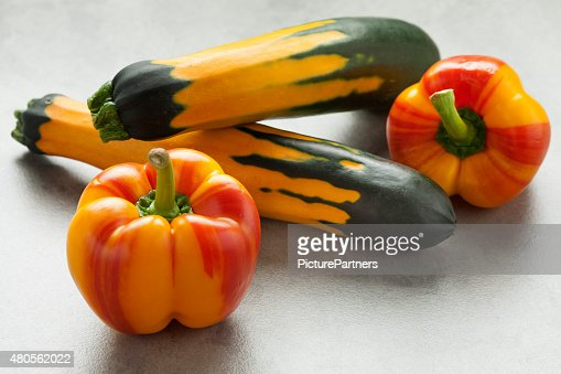 Fresh striped peppers and zucchini : Stock Photo