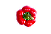Fresh succulent red bell pepper with its green stalk, a rich source of vitamin c, the antioxidant lycopene, and active against cardiovascular disease, viewed from above on white with copyspace