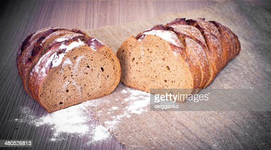 Pane fresco gustoso con Woody sfondo : Foto stock