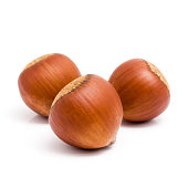 Fresh three hazelnuts isolated on white background.