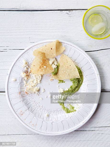 Fresh tomatillo salsa with chips, soft mexican cheese and lime soft drink
