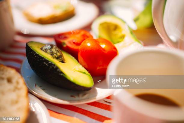 Fresh tomato and avocado ready for breakfast.