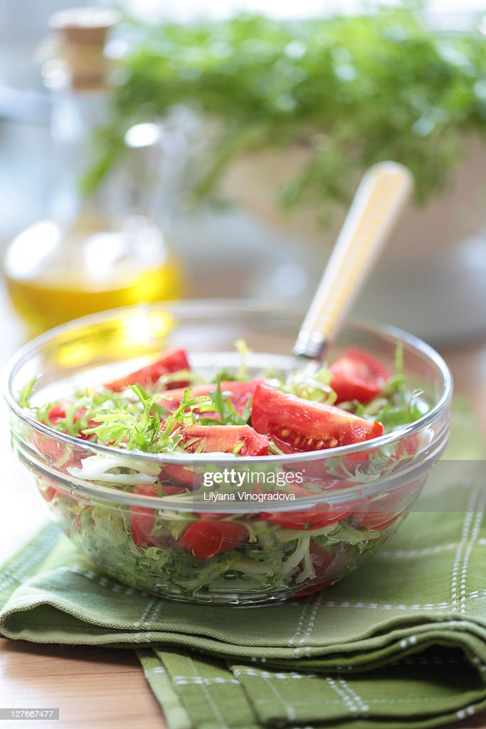 Fresh tomato and curly endive salad : Stock Photo