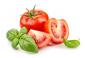 fresh tomatoes and basil leaves isolated on white background