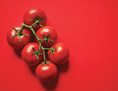 Fresh tomatoes photographed rustic style on wood background