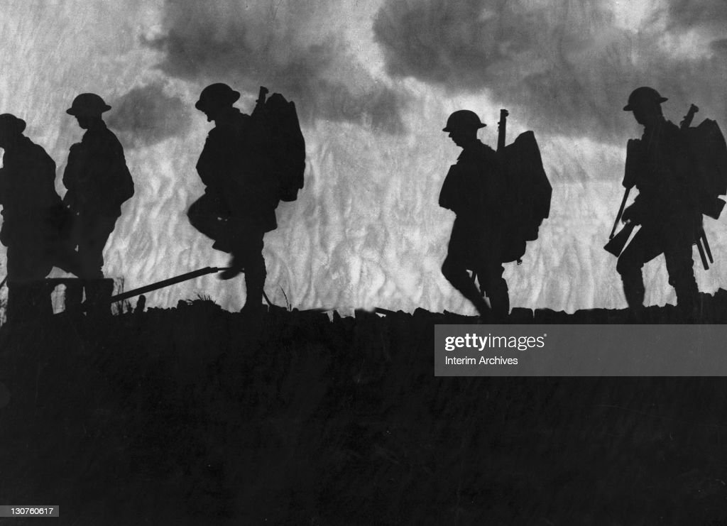 Fresh troops a Yorkshire regiment is seen silhouetted against the dusk while moving up to an advanced position France during World War I US Army photo