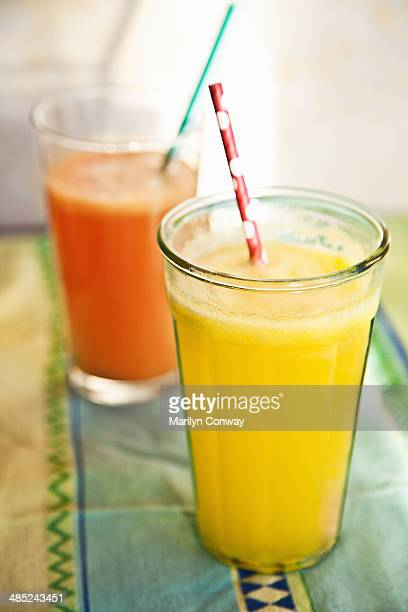 Fresh tropical fruit juices on table