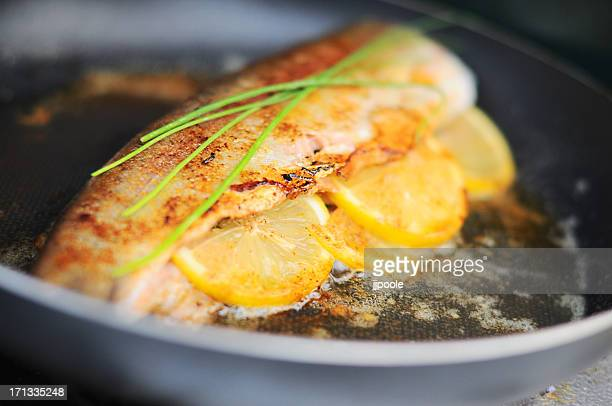 Fresh trout cooking in skillet