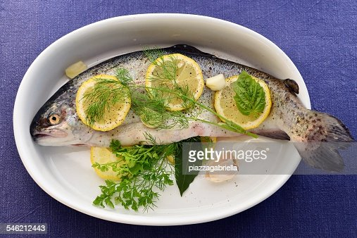 Fresh trout served in white bowl
