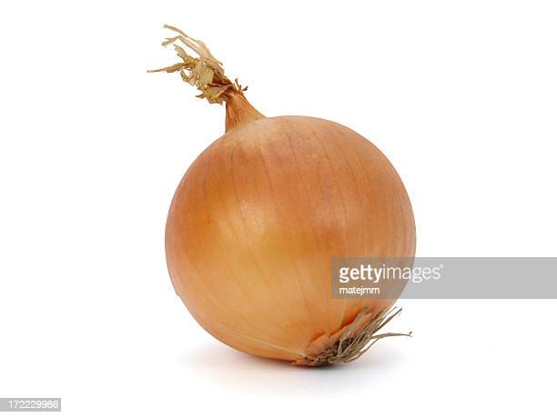 Fresh unpeeled onion on white background