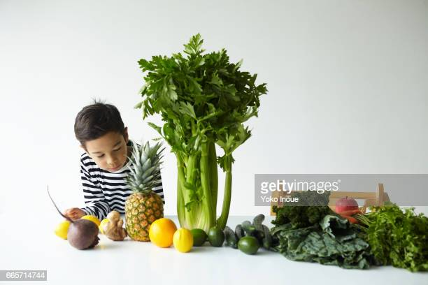 Fresh vegetables and Fruits and young boy