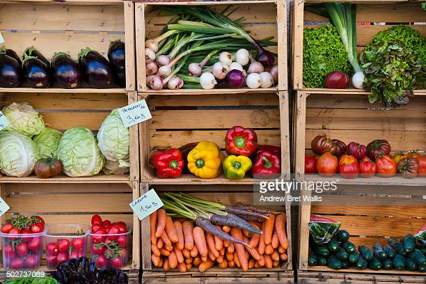 Fresh vegetables for sale on a market stall