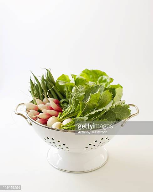 Fresh vegetables in a colander