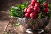 fresh vegetables in a metal colander ,healthy food on a wooden vintage table