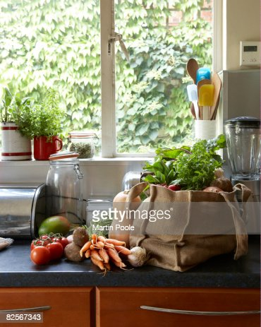 fresh vegetables in canvas bag on kitchen counter : Stock Photo