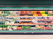 Fresh vegetables on shelf in supermarket for background