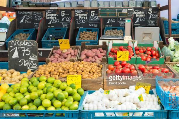 Fresh vegetables on vegetables market in Amsterdam, Netherland. Many vegetables in basket for sell. Vegetables retail in Amsterdam, Netherlands