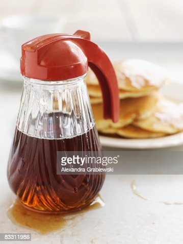 Fresh Vermont maple syrup with pancakes