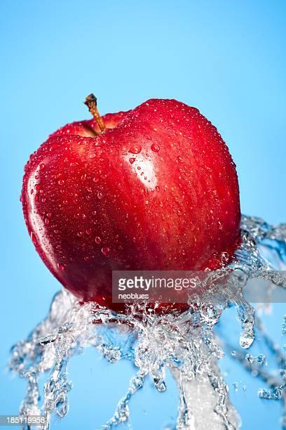 fresh water splash and red apple