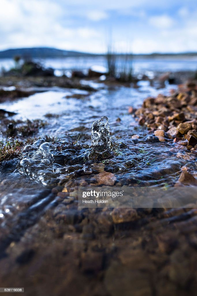 Fresh water springs from the ground and runs down the shoreline on May 4, 2016 in Great Lake, Australia. Heavy snow and rain fall in the area has seen much needed water flow into the lake. Tasmania's dams are at record lows due to lower than average rainfall with storage levels of dams used to generate hydro power below 15 per cent for the first time.