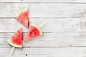 Fresh watermelon slices on wooden background. Top view with space for your text