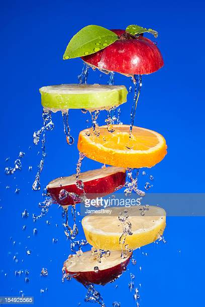 Fresh Wet Fruit Slices Tossed in Air