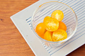 Fresh yellow tomatoes in a bowl