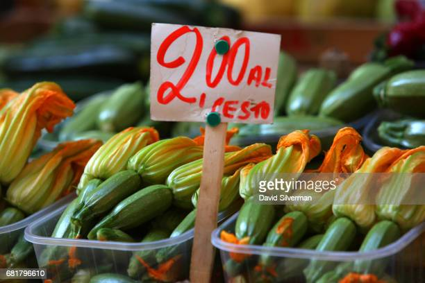 Fresh zucchini flowers are on sale for 2 Euro for each container at a produce stall in the ancient Quadrilatero market on March 30 2017 in Bologna...