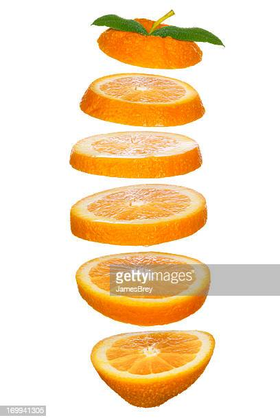 Fresh-Cut Orange Slices Tossed in the Air